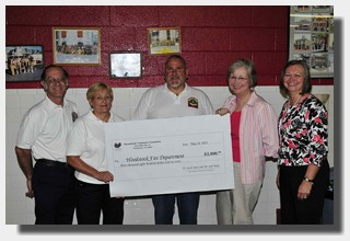 Foundation officers present grant check to the Woodstock Fire Department
